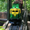 Garden Railroad : G scale train runs through garden.
